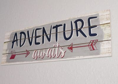Adventure Awaits Signage
